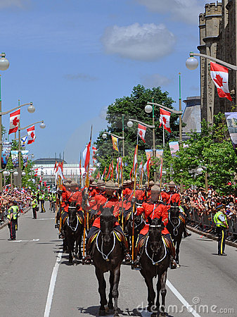 RCMP riding in Canada Day, Ottawa Editorial Stock Image