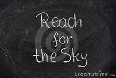 Reach for the sky phrase on blackboard