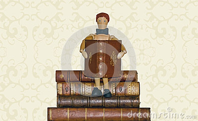 Reader, sitting on pile of books