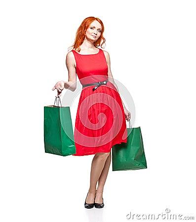 Readhead with green shopping bags