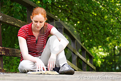 Reading the Bible in the Park