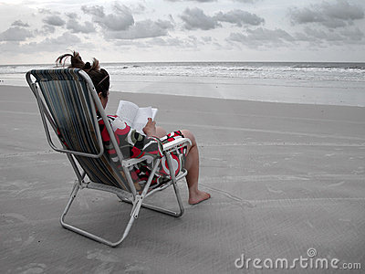 Reading a book in the beach