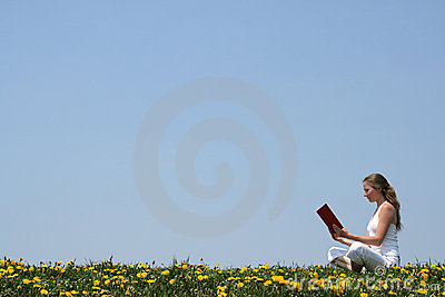 Reading a book outdoors