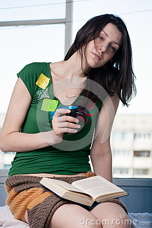 Reading and drinking hot