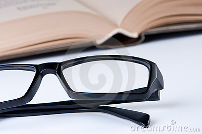 Reading glasses with open book.