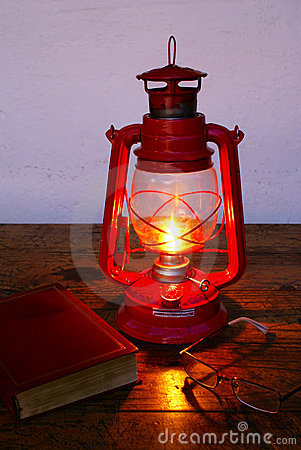 Reading at kerosene lamp light
