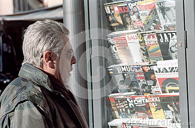 Reading magazines Editorial Photography
