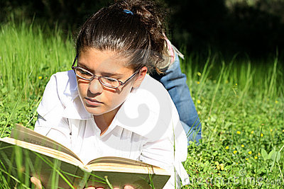 reading outdoors at summer camp