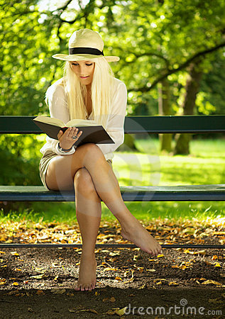Reading In A Park Stock Photos - Image: 21469383