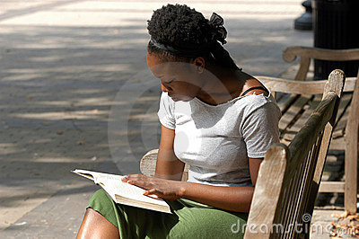 Reading on a park bench