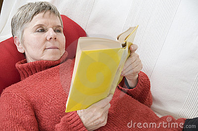 Reading on the settee bed