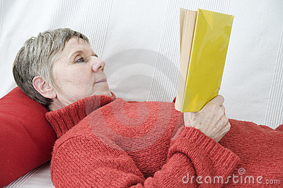 Reading on the settee bed side