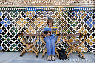 Reading a tourist guide Editorial Stock Photo
