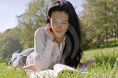 Reading woman on a grass