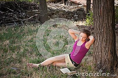 Reading woman in a meadow