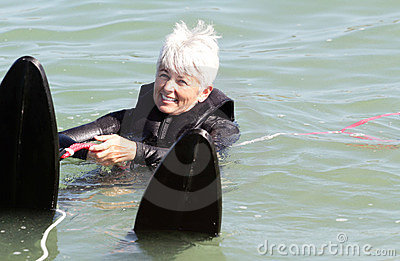 Ready Set Go. Older Lady Water Skiing. Copy Space.