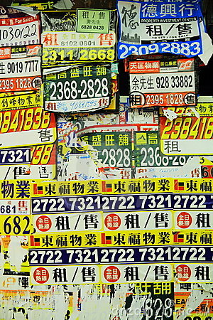 Real estate advertising posters in Hong Kong Editorial Stock Photo
