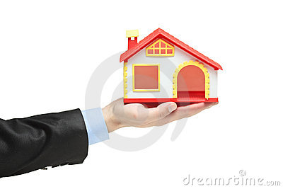 Real Estate Agent Holding A Model House In A Hand Stock Photos - Image: 14688923