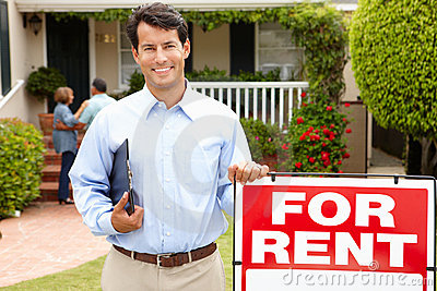 Real estate agent at work outside a property