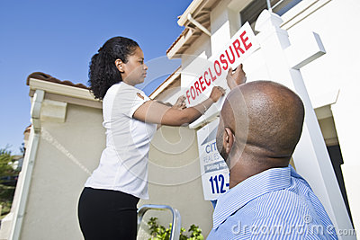 Real Estate Agents Putting ~For Sale~ Notice Outside House