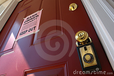 Real Estate Bank Foreclosure Notice on House Door