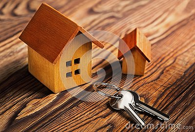 Real estate concept with house and key on wooden background. Idea for real estate concept, personal property an Stock Photo