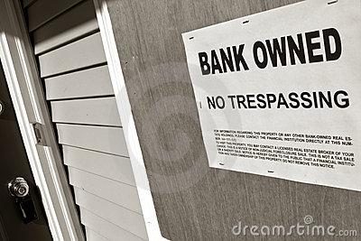 Real Estate Foreclosure Bank Owned Sign on House