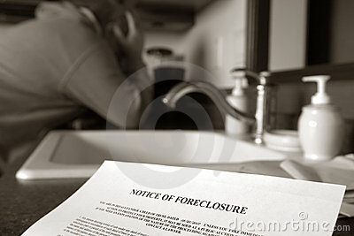 Real Estate Foreclosure Notice and Man Crying