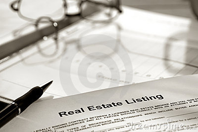 Real Estate Listing Contract Documents and Ink Pen