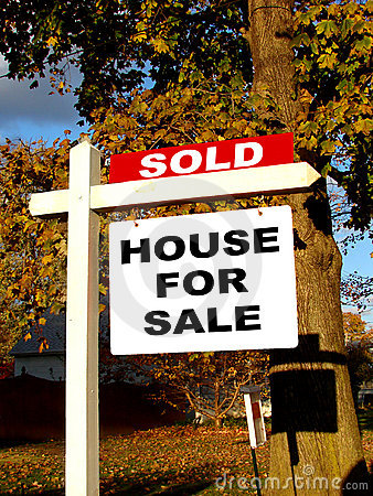 Real Estate Sold and House For Sale Sign on Post