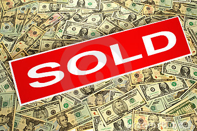 Real Estate Sold Sign over Dollar Money Background