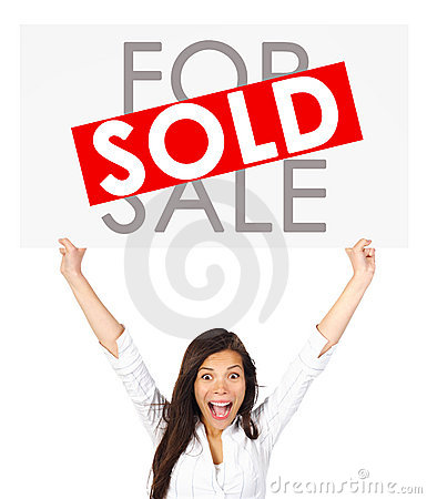 Real estate woman holding sold sign