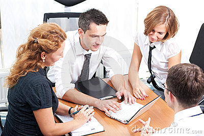 Real office workers posing for camera
