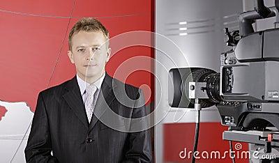 Real Presentor in TV studio in front of camera