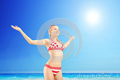 Realaxed female tourist spreading her arms and gesturing freedom