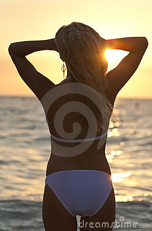 Rear View Blond Woman On Beach In Bikini At Sunset