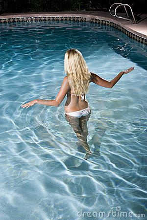 Rear view of blond woman in pool