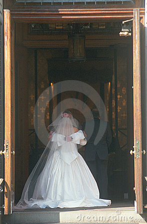 Rear View Of Bride Entering Church Royalty Free Stock Photo - Image: 23148945