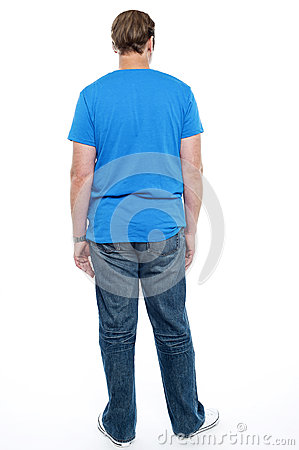 Rear view of casual young guy posing