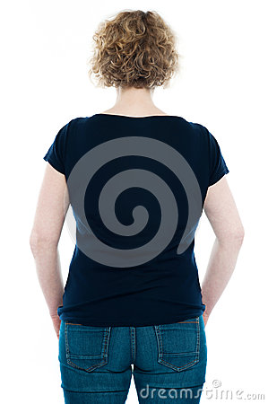 Rear view of curly haired stylish caucasian woman