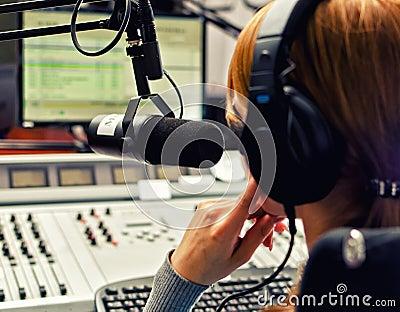 Rear view of female dj working