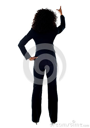Rear view of female pointing at copy space