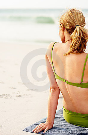 Rear View Of A Female Sitting Relaxed At The Beach Royalty Free Stock Photo - Image: 10771705