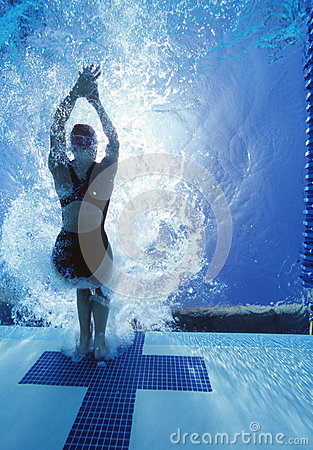 Rear view of female swimmer in competition