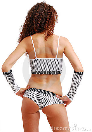 Rear view of frizzy girl in polka dot clothes.