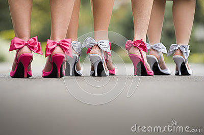 Rear view of a group ladies wearing colourful bow high heels