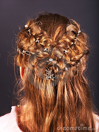Rear view of  hairstyle with braiding.