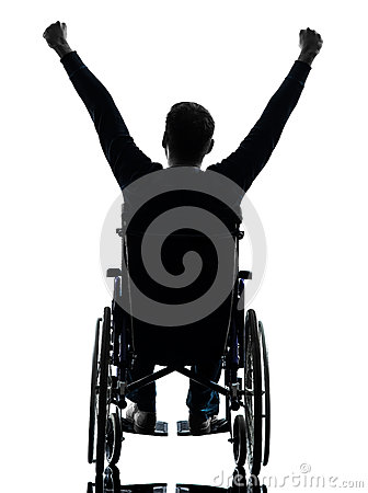 Rear view handicapped man arms raised  in wheelchair silhouette