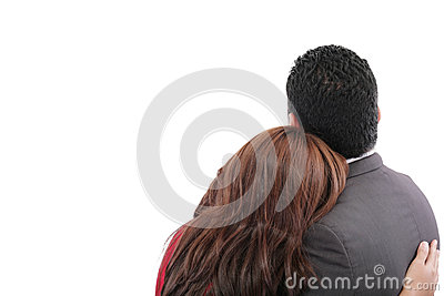 Loving couple standing with arms around
