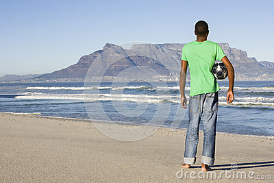 Rear View Of Man With Football At Table Mountain Beach